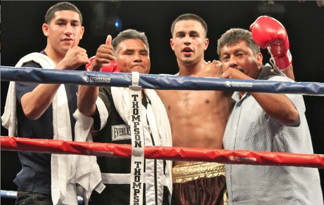 After defeating Robert Crespo in Corona, CA, Oscar Godoy and his support group look out at the cheering fans.