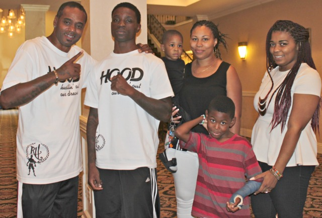 At the conclusion of the weigh-ins, Riccy Hood and his coach Tiger Smalls pose for a photo with Hood's family.