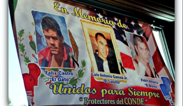 "This memorial banner, which hangs in the United Boxing Gym in South San Diego, showcases (l to r) Felix ""El Gato"" Castro, Luis Antonio Gamez Jr. and Pablo ""Bronco"" Armenta, three very popular and outstanding boxers who lost their lives tragically at a young age."