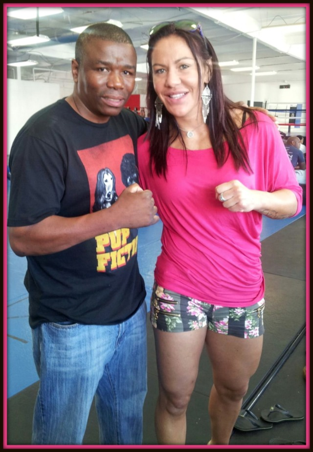 Coach Lucky-Pheneas Nhlengethwa poses for a photo with the legendary Mixed Martial Artist Cris Cyborg Santos who sought Lucky's help to improve  on her striking skills.