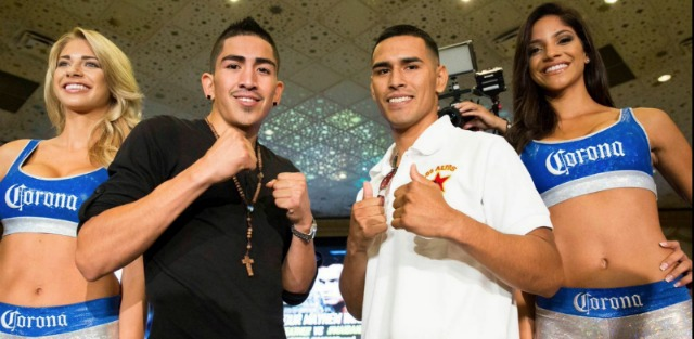 """At Tuesday's press conference for """"Mayhem: Mayweather vs. Maidana 2"""" the two gentleman in the co-main event Leo Santa Cruz  and Manuel Roman are shown posing for photos. Esther Lin/Showtime"""