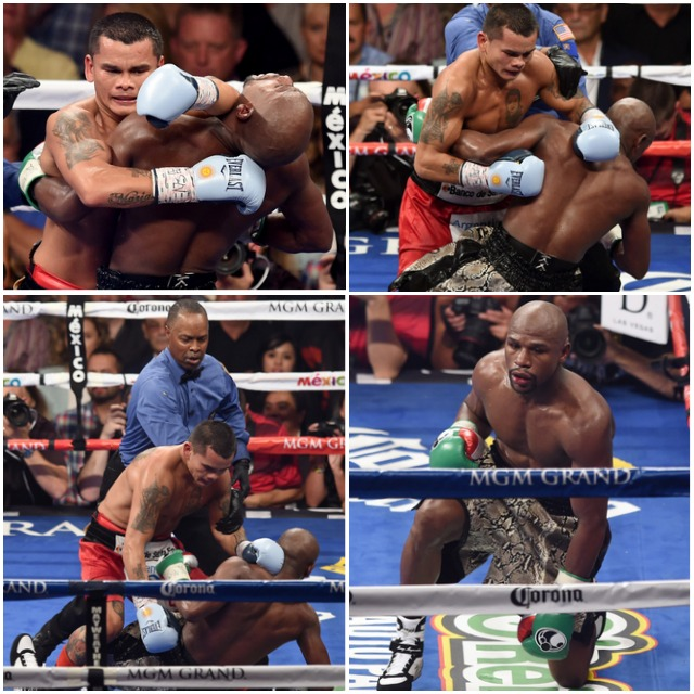 The wrestling match that ends with a shove by Marco Maidana. (L-R) Floyd Mayweather Jr. and Marcos Maidana get tangled up during their WBC/WBA welterweight title fight at the MGM Grand Garden Arena on September 13, 2014 in Las Vegas, Nevada. (Photo by Ethan Miller/Getty Images)