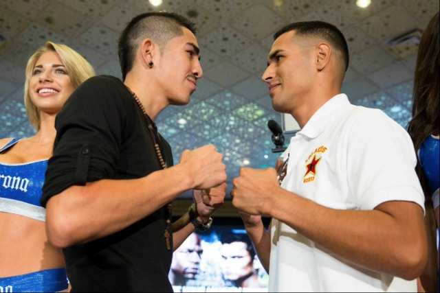They were all smiles today, but they won't be on Saturday night. Leo Santa Cruz (l) and Manuel Roman (r) face off for the benefit of the many photographers. Esther Lin/Showtime