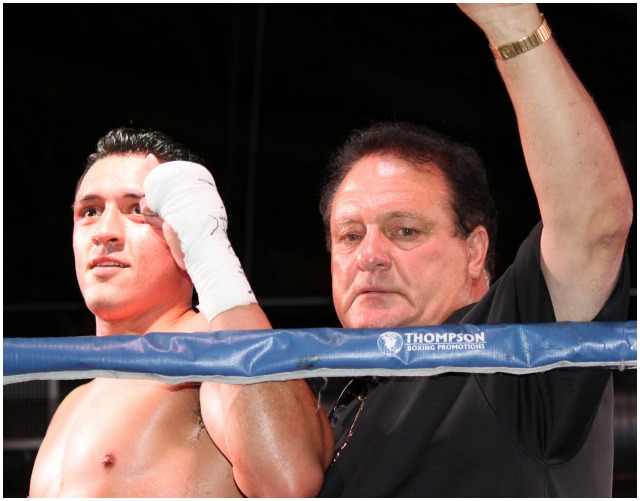 Both the fighter and his manger Mr. Bob Calhoun give a pump fist to the cheering crowd. Photo: J. Wyatt