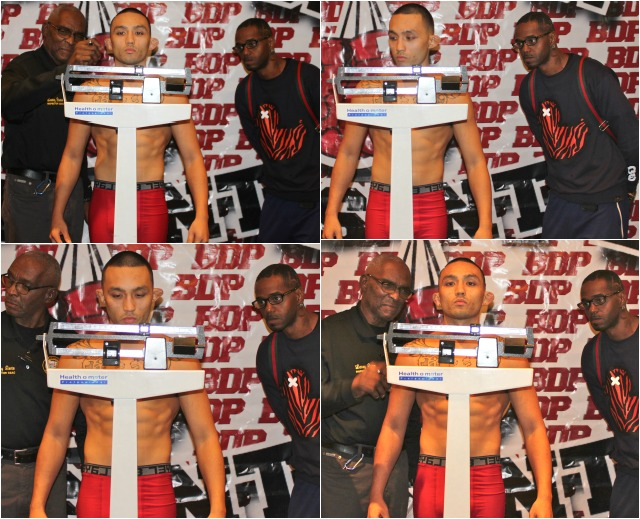 Boxing coach Priest Tiger Smalls (r) keeps a keen eye on the scale as his boxer's opponent Don Jose weighs in. Photos: Jim Wyatt