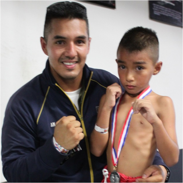After his grueling battle with Canelito Kristian, Mike Casillas poses for a photo with his oh so proud father.