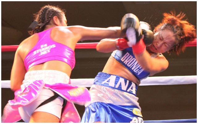 "Here we Kenia Enriquez (l) unloading another big overhand right to the chin of her opponent Ana ""La Bronca"" Arrazola in what turned out to be an easy win for the new WBO Female Flyweight World Champion. Photo: Jim Wyatt"