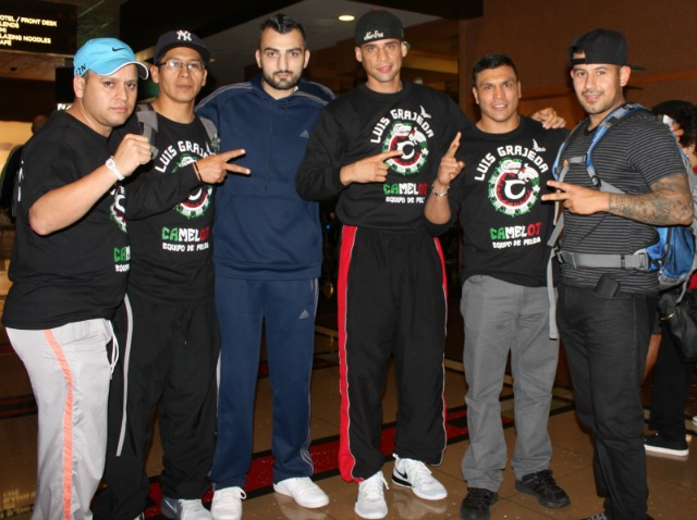In this photo we see Vane Martirosyan joining the Luis Grajeda support group which includes the boxing great Daniel Ponce de Leon. Photo: Jim Wyatt