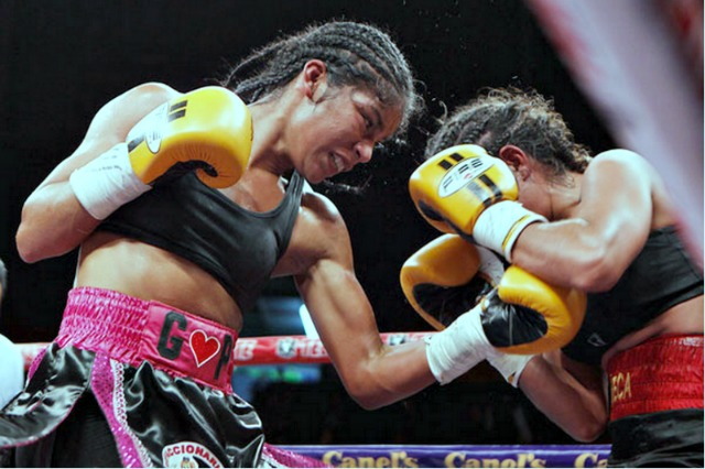 "Here we see Sandra ""Perla Negra"" Robles of Tijuana, B. C., Mexico landing one of her powerful left uppercuts on her opponent Linda ""La Muneca"" Soto from Puerto Penasco, Sonora, Mexico."