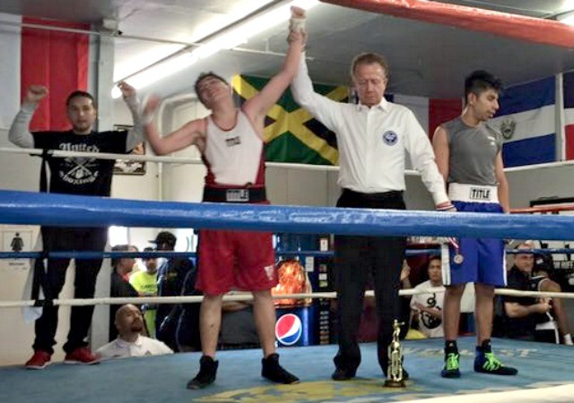 """Eduardo """"Fearless"""" De La Torre (l) had his arm raised in victory after earning an unanimous decision victory over Jose Cruz of the highly touted Robert Garcia Gym of Oxnard, CA."""