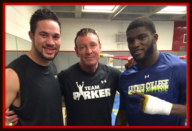 Heavyweight boxers Joe Parker (l) and Izu Ugonoh (r) are joined by coach Kevin Barry after their sparring session.