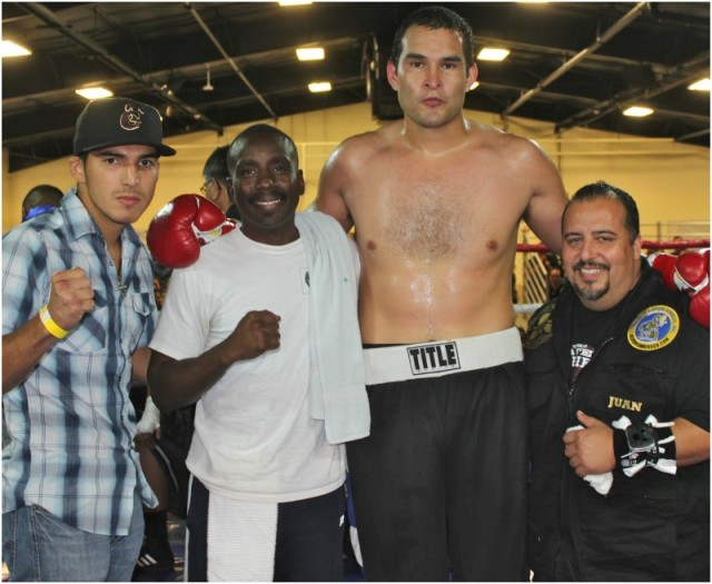 At the conclusion of his bout against Michael Robinson, the victorious Rafael Rios poses for a photo with his support group.