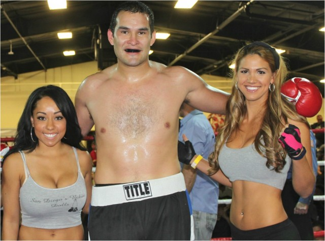 Rafael Rios has time for another photo. This time with the lovely ring card girls.