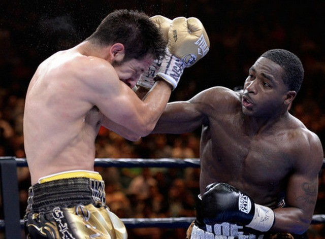 Adrian Broner is shown clobbering his opponent John Molina Jr. All photos: Harry How/Getty Images