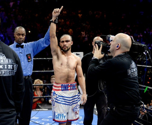 Keith Thurman has his arm raised by referee Kenny Bayless. Photo: Harry How/Getty Images