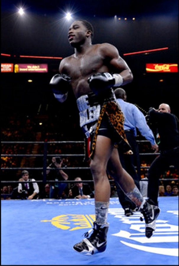 As the fight ends, Adrian Broner dashes towards one of the corners to scale the ropes and give a salute to his fans - all 12 of them. cameraman desperate to get the shot ofropes