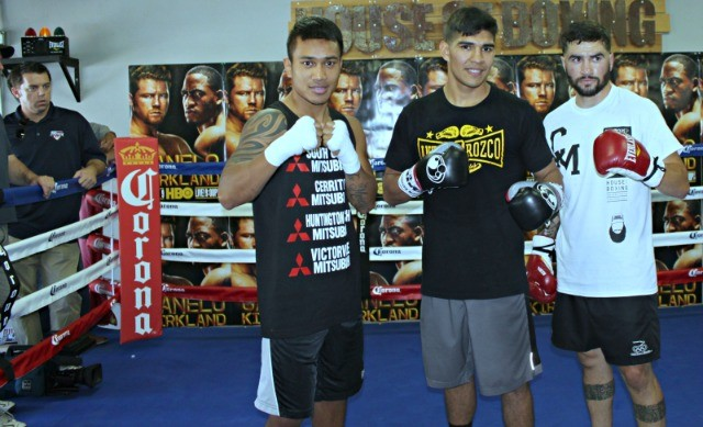 Three of the four principles in the upcoming Golden Boy Promotions Mega Fights pose for photos Monday April 20, 2015 at the House of Boxing Gym in Paradise Hills, San Diego, California.