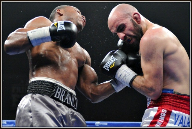 As part of his beat-down, Brandon Adams (l) lands a solid uppercut to Vito Gasparyan's chin.