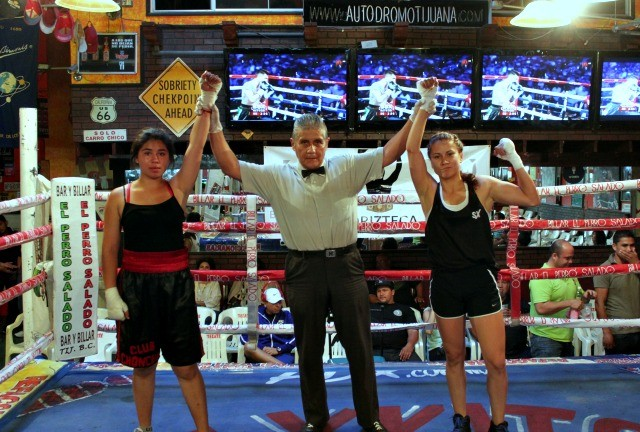 In the famale exhibition bout it was Paulette Valenzuela (r) giving Slugey Fonseca a boxing lesson. All photos: Jim Wyatt