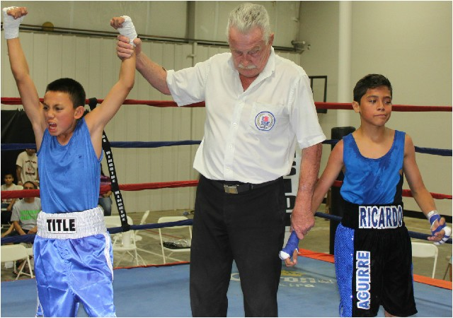 At the conclusion of their bout, it was Isaiah Torres (l) having his arm raised in victory by referee Rick Ley.