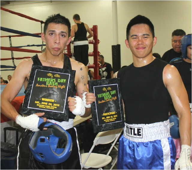 After leaving the ring, the two boxers (l to r) Pedro Bernal and Nico Marchan pose for a photo together. All photos: Jim Wyatt