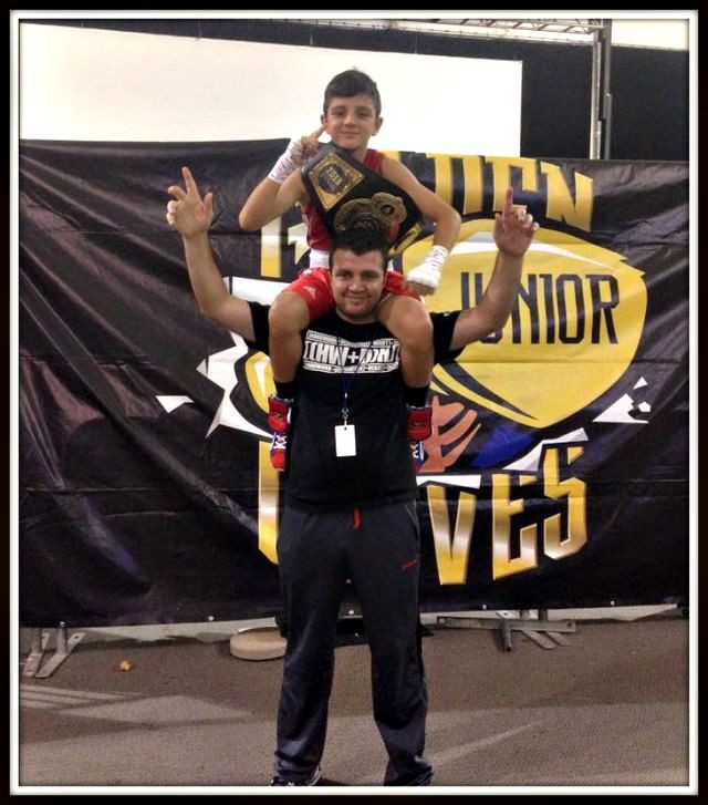 In this photo we see Julius Ballo after he was hoisted up on his father's shoulders. That same day, Saturday, July 25, 2015, Ballo was a winner at the 2015 Jr. Golden Gloves Competition.