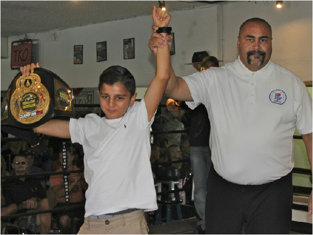 During intermission, Hondo Fontan, the local USA Amateur Boxing President had boxer Julius Ballo come up to the ring. Last week, Ballo defeated 3 boxers on his way to winning the Jr. National Pal Tournament.