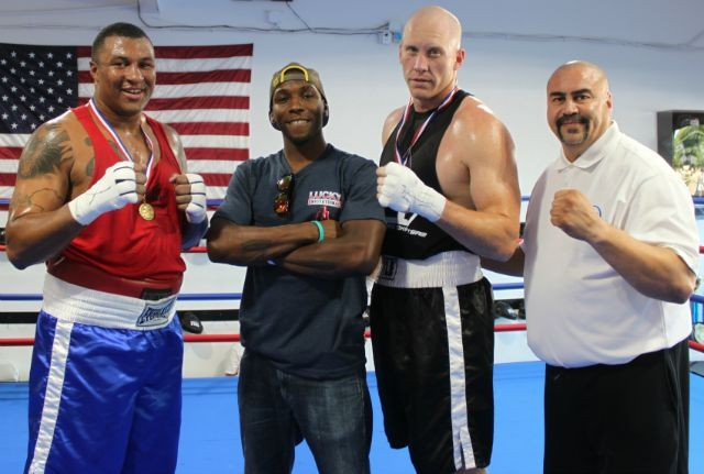 Lucky Invitational, August 15, 2015: Everyone looks forward to amatch featuring the Super Heavyweights. On Saturday, in Bout #19 it was Jvon Wallace (l) facingAdam Stewart (r). Also shown: Mixed Martial Artist/Muay Thai fighter Devin Taylor and Hondo Fontan, current President of USA Amateur Boxing's LBC 44. Photo: J. Wyatt