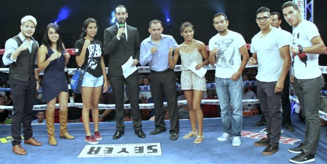 "During a brief intermission, some of the best athletes in the sport were introduced by the show's distinguished ring announcer, Pablo Flores, (l to r) Diego Magdaleno, with his new hair color, Amaris ""Diamond Girl"" Quintana, Tania Enriquez, the show's co-promoter Saul Rios, Sandra ""La Perla Negra"" Robles, Hector ""Charro Negro"" Velazquez, Antonio ""Relentless"" Orozco and Miguel ""Zurdo"" Sanchez. Photo: J. Wyatt"