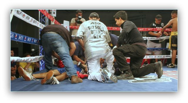 In his debut, Armando Tovar of San Diego's House of Boxing (far right, with gloves being removed) scored an exciting first round knockout of Jose Neri shown here being attended to by coach Ray Solis and physicians from the Tijuana Boxing Commission.