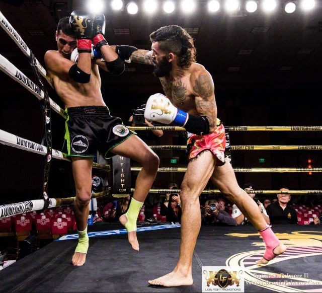 Classic photo of Antonio Arango of Valor Muay Thai landing a short right cross to the side of Ardavan's head. Notice both of Ardavan's feet are off the ground. Photo: Lion Fight Promotions/Bennie E. Palmore II
