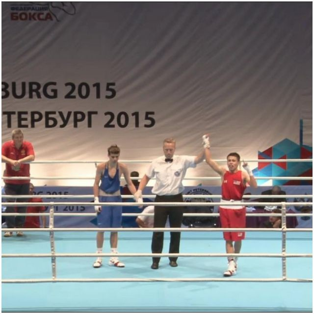 Marc Castro (r) has his arm raised in victory at the 2015 AIBA Tournament.