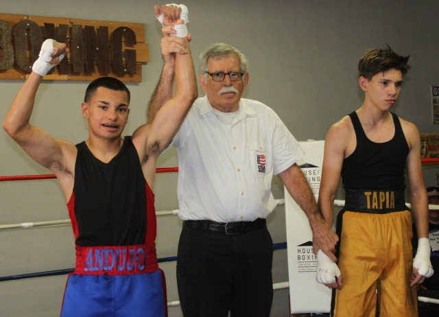 At the conclusion of Bout #1, veteran referee Will White raises the arm of the victorious Daniel Andujo who ended up getting a TKO victory over Baja Boxing's Robert Tapia.