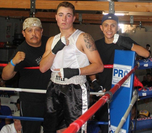 Anthony Franco of The Arena gym in Point Loma poses for a photo with his stablemate Jason Meza and his father Meza who worked his corner.