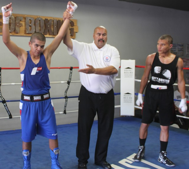 Rene Martinez (3-1, 132 lbs.) of Romo's Boxing going up against 16 year-old Kennedy Ruiz (132 lbs.) from City Boxing in San Diego's downtown.