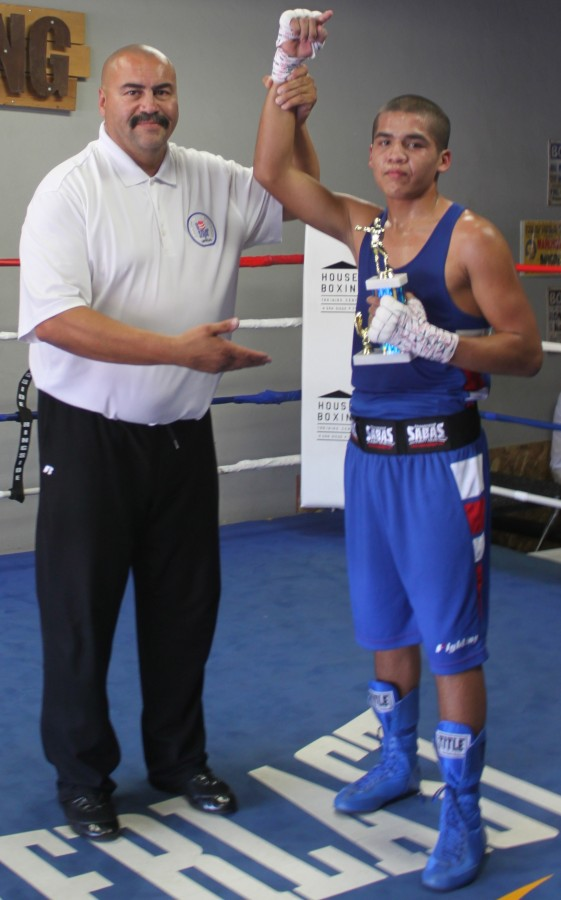 At the conclusion of Bout #11, we see Hondo Fontan, the local USA Amateur Boxing LBC 44 President raising the arm of the victorious Renee Martinez who now improves his record to 4-1.