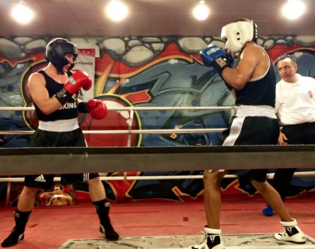 "Kyle Erwin of the Nevarez Boxing Team (l) and Isaac Alvarez (unattached) face off to start the ""Friday Night Fights on Broadway"" USA Amateur Boxing Show."