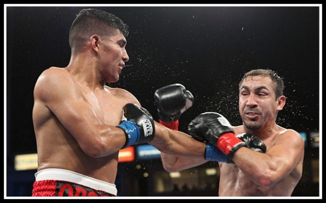 In this one youth won out as Antonio Orozco (l) kept beating his opponent, Humberto Soto, (r) to the punch.