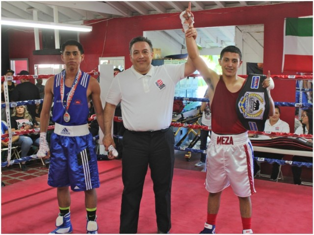 At the conclusion of Bout #4, it was Jason Meza of The Arena (r) having his arm raised in victory by referee Alberto Ramos.