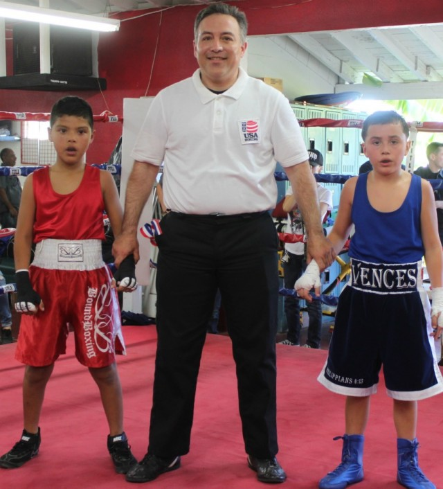 (l to r) Sammy Vences (4-2, 73.2 pounds) of Max Impact Boxing, Oceanside, Calif. come away with the victory over 11 year-old Jon Carlos Meza