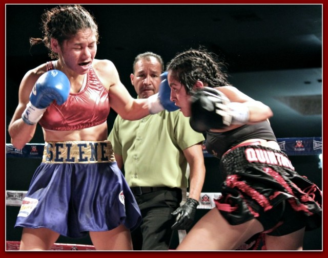 During Saturday's Co-main event at the Salon Mezzanine in Tijuana, B. C., Mexico, we see Amaris Quintana (r) timing her punch with the punch of her opponent Selene Lopez. For sure it's not what a parent or a coach likes to see but it is full blown entertainment that the boxing fan loves. Photo: Jim Wyatt
