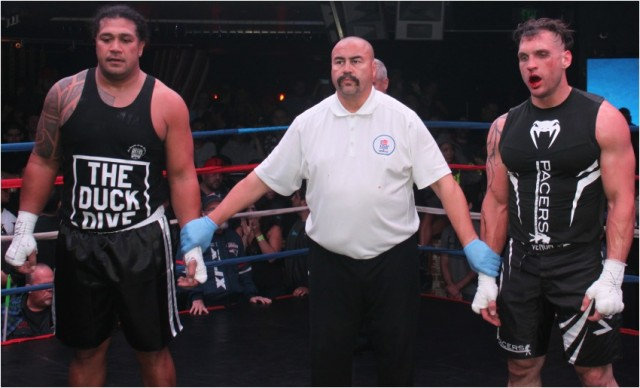 At the end of Bout #13, we see referee Hondo Fontan standing between the combatants, the physically drained Cameron Allen (r) and Tony Tata (l) who doesn't appear to have broken a sweat.