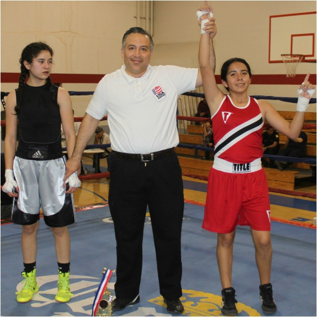 """At the conclusion of her bout against Karla Saldana referee Alberto """"Cookie"""" Ramos"""
