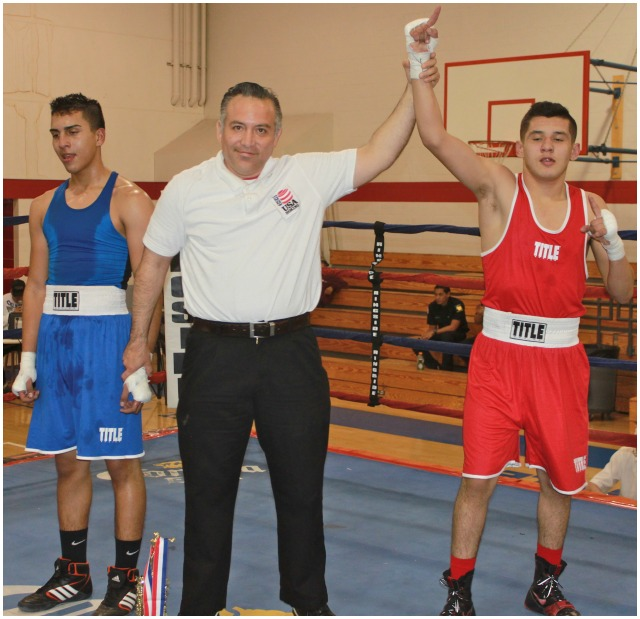 """At the conclusion of Bout #3 we see Santiago Renteria having his arm raised in victory by referee Alberto """"cookie"""" Ramos"""