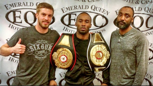 Here we see Dashon Johnson holding his California State Super Welterweight title plus his WBA NABA US Super Middleweight title with two of his biggest supporters trainer Jermaine Simpkins and Terry Strawson.