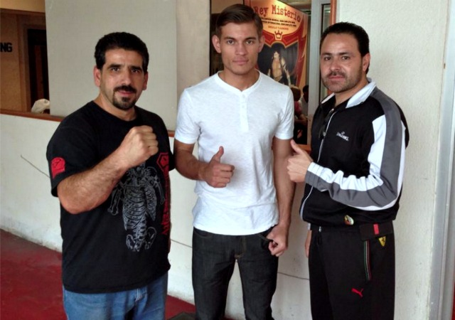 (l to r) Trainer/manager/friend Luis Lorenzo, boxer Cristian Olivas,