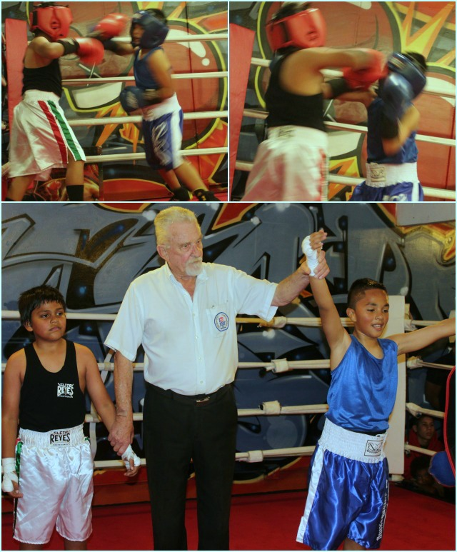 At the conclusion of Bout #3, we see referee Rick Ley raising the arm of the victorious