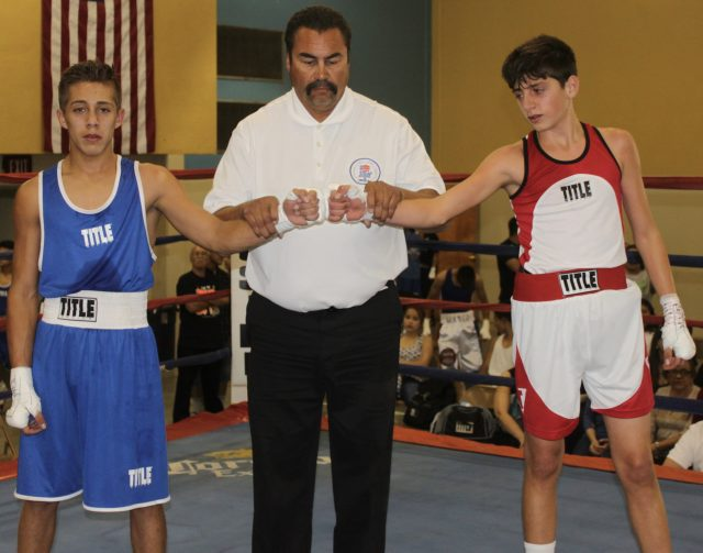 In Bout #1, it was 16-year-old Eduardo Lopez (left, blue trunks, 113.4 pounds, experience: 2 bouts) of Calexico Boxing, Calexico, Calif. coming away with the victory over 15-year-old Jonathan Mansour of the Bombers Squad in El Cajon, Calif. (106.4 pounds, experience: 3 bouts).