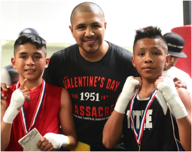 After their grueling battle Art Barrera (l) and Emiliano Vargas pose