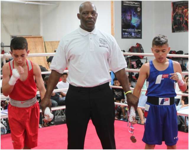 At the close of Bout #4, we see both Amed Medina (l) and Daniel Morales wishing and a hoping for the victory.